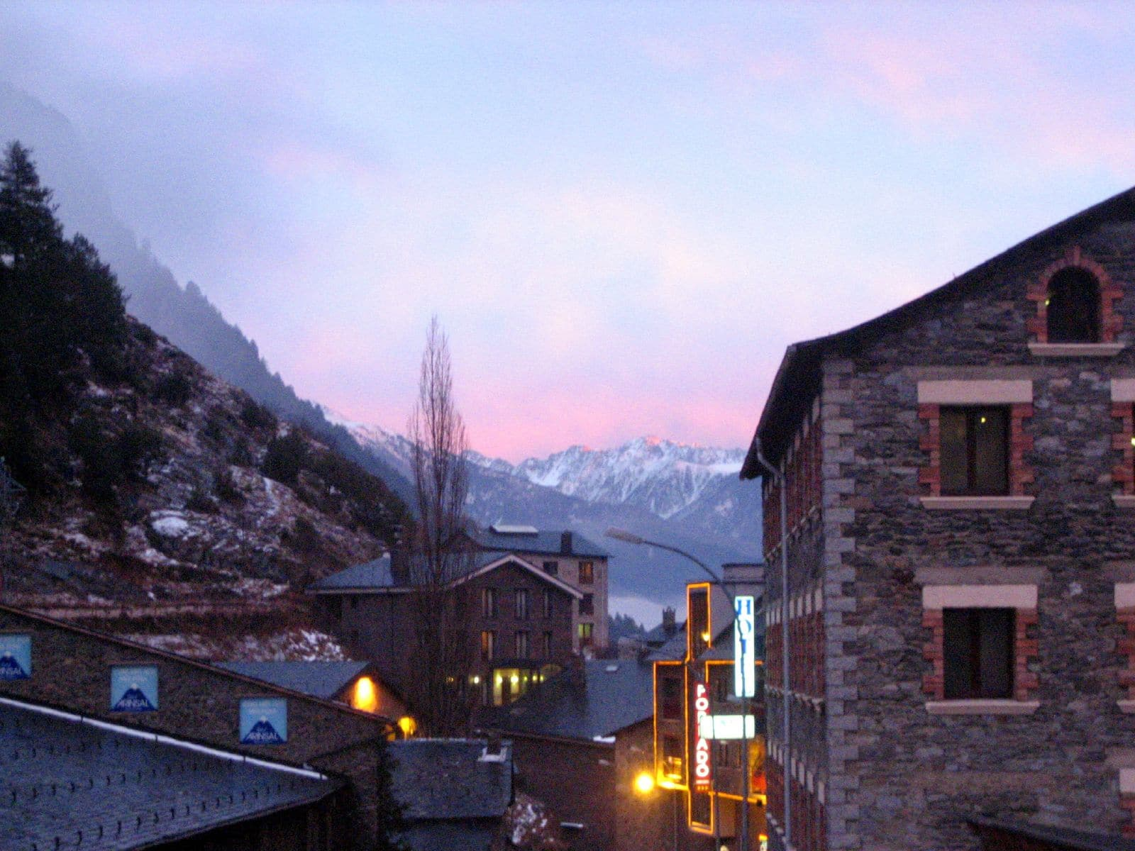 At night in Arinsal neon highlights mix with the traditional architecture.