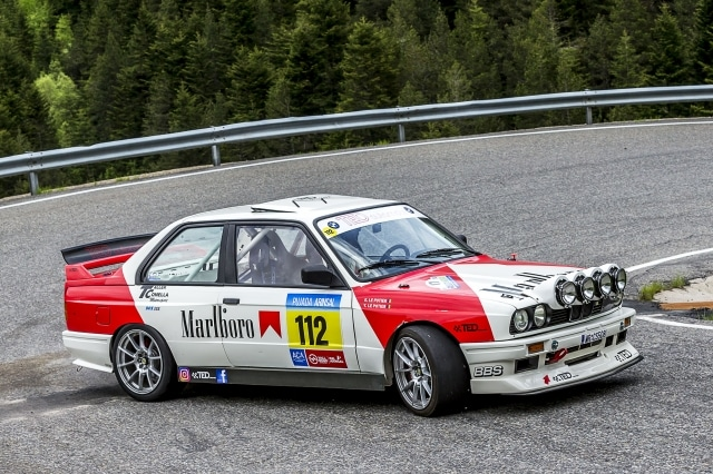 A BMW E30 M racing in La Pujada