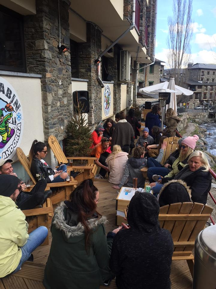 The riverside patio at El Cabin is a relaxing spot after a day of skiing.